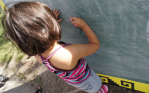 "Green Apple Day ""Little Girl Drawing on Chalkboard"""
